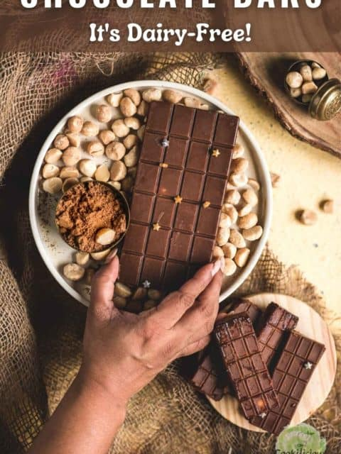 a hand reaching out to grab a Vegan Chocolate Macadamia Bar and text at the top