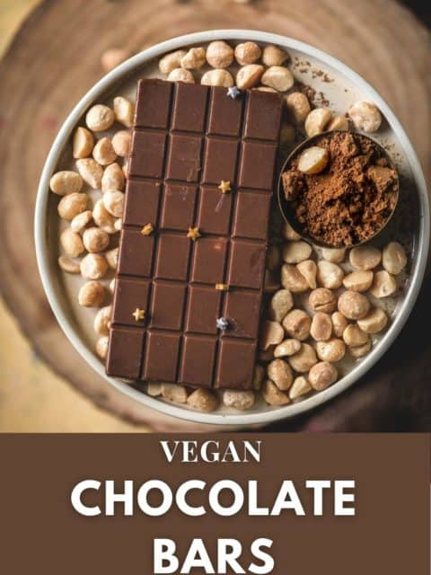 Vegan Chocolate Macadamia Bar served on a platter with macadamia nuts around it and text at the bottom