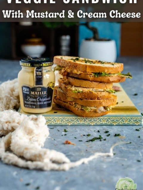 Maille mustard jar and veggie sandwich with text at the top