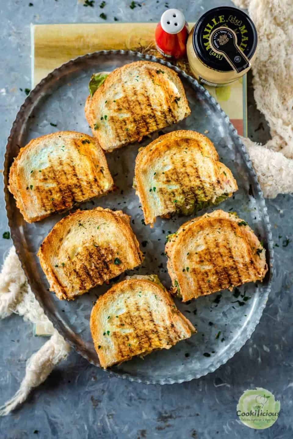 veggie sandwiches cut and served in a tray