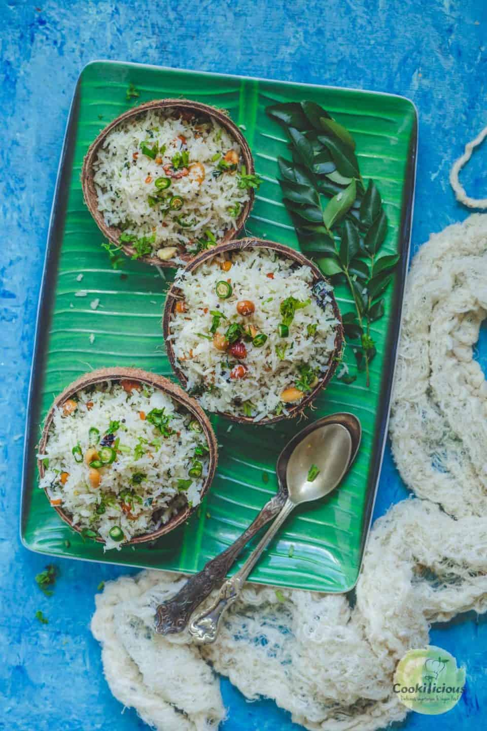 3 coconut bowls filled with South Indian Coconut Rice in a tray