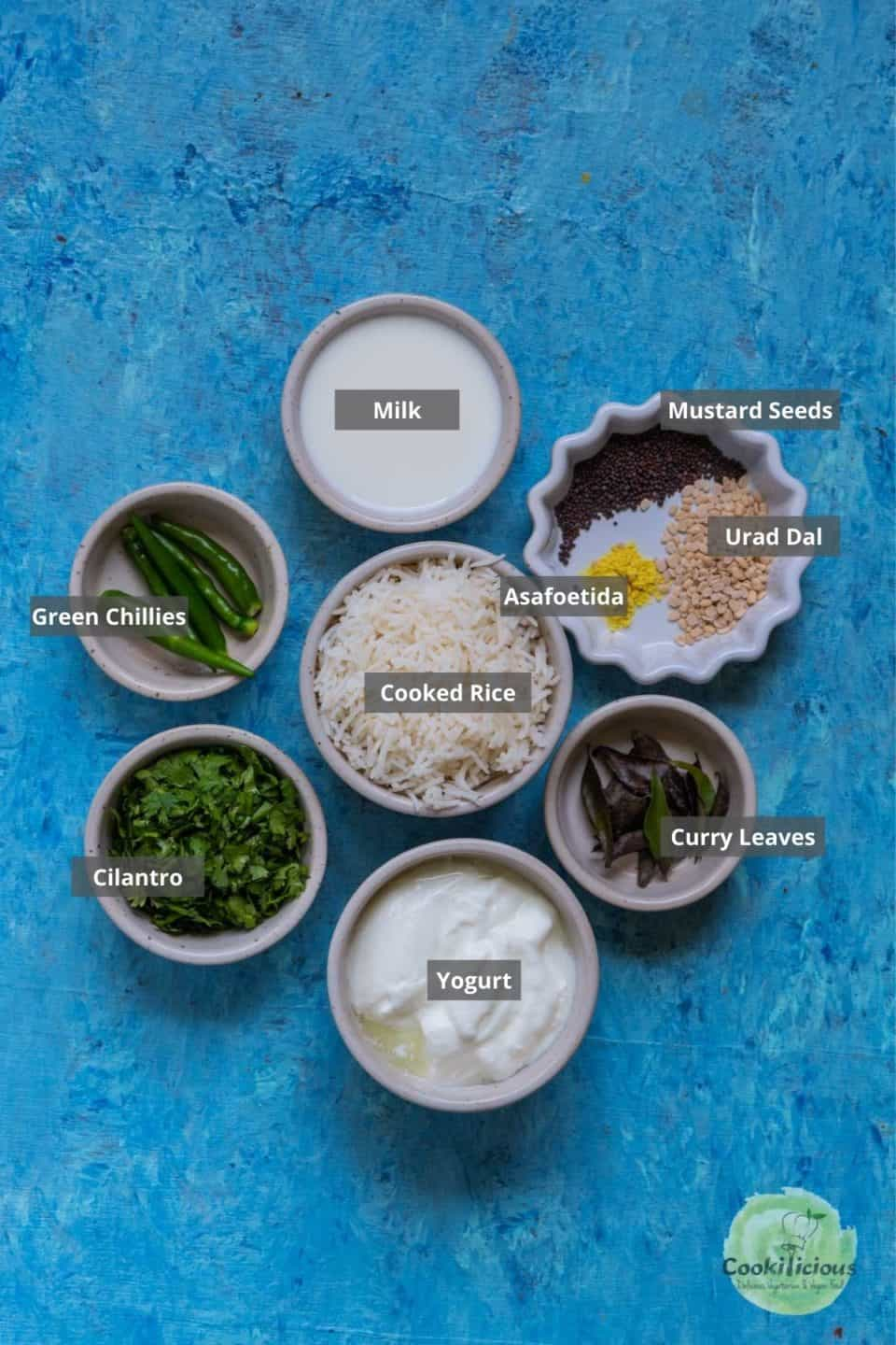 all the ingredients needed to make curd rice placed on a table with labels on them