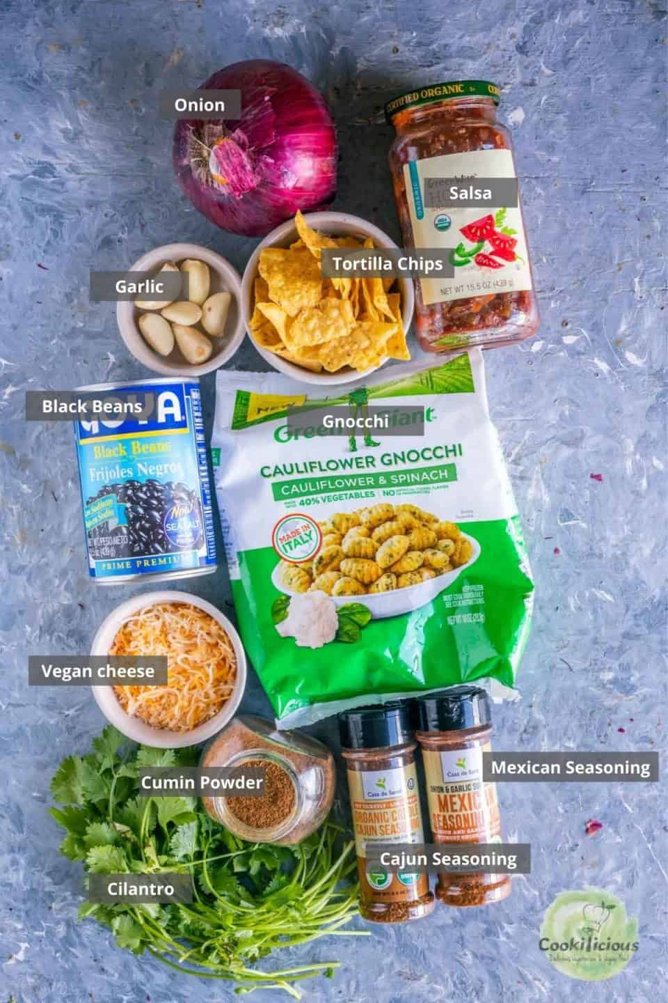 all the ingredients needed to make Vegan Mexican casserole placed on a table with labels on them