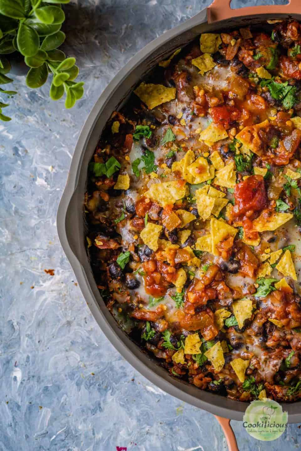 view of half a skillet filled with Vegan Mexican gnocchi casserole