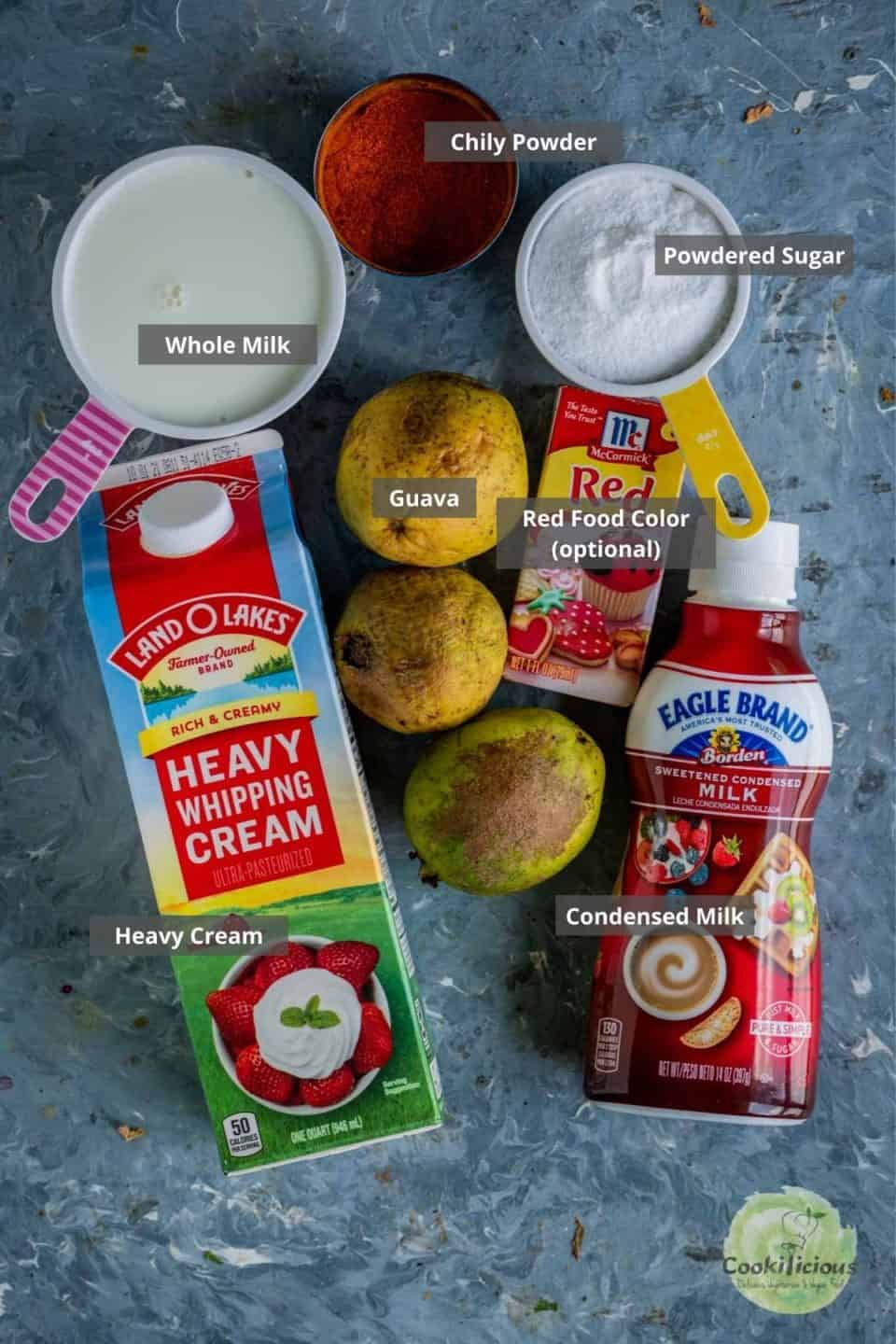 all the ingredients needed to make guava ice cream placed on a table with labels on them