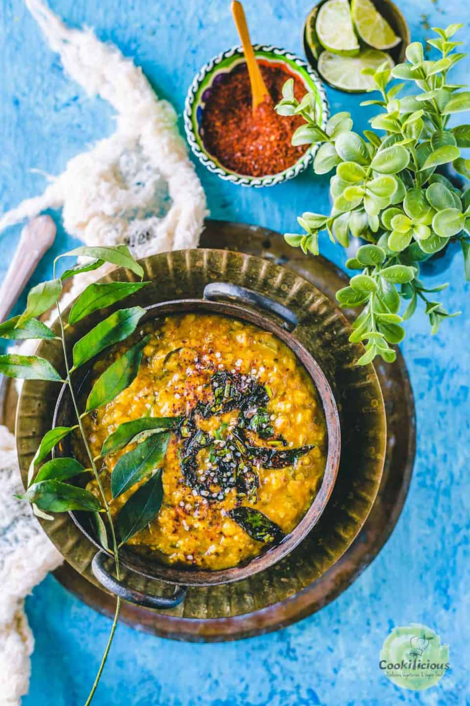 Methi Dal served in a kadai and placed on a plate