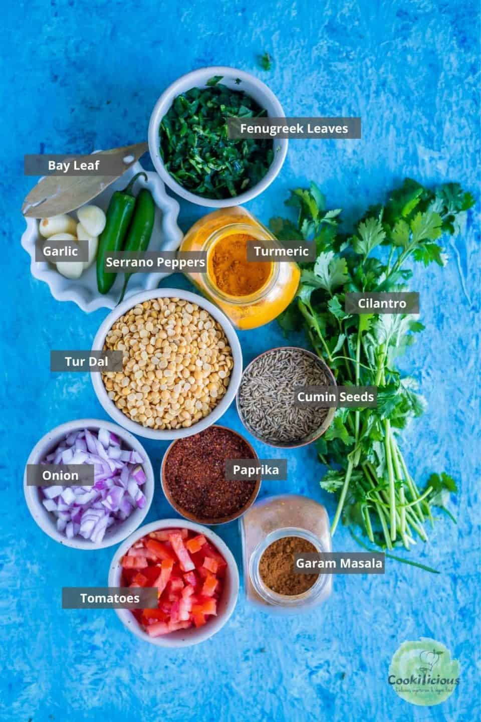 all the ingredients needed to make Methi Dal placed on the table with labels on them