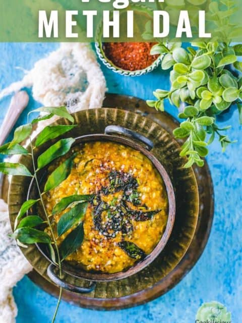 Methi Dal served in a kadai and placed on a plate with text at the top