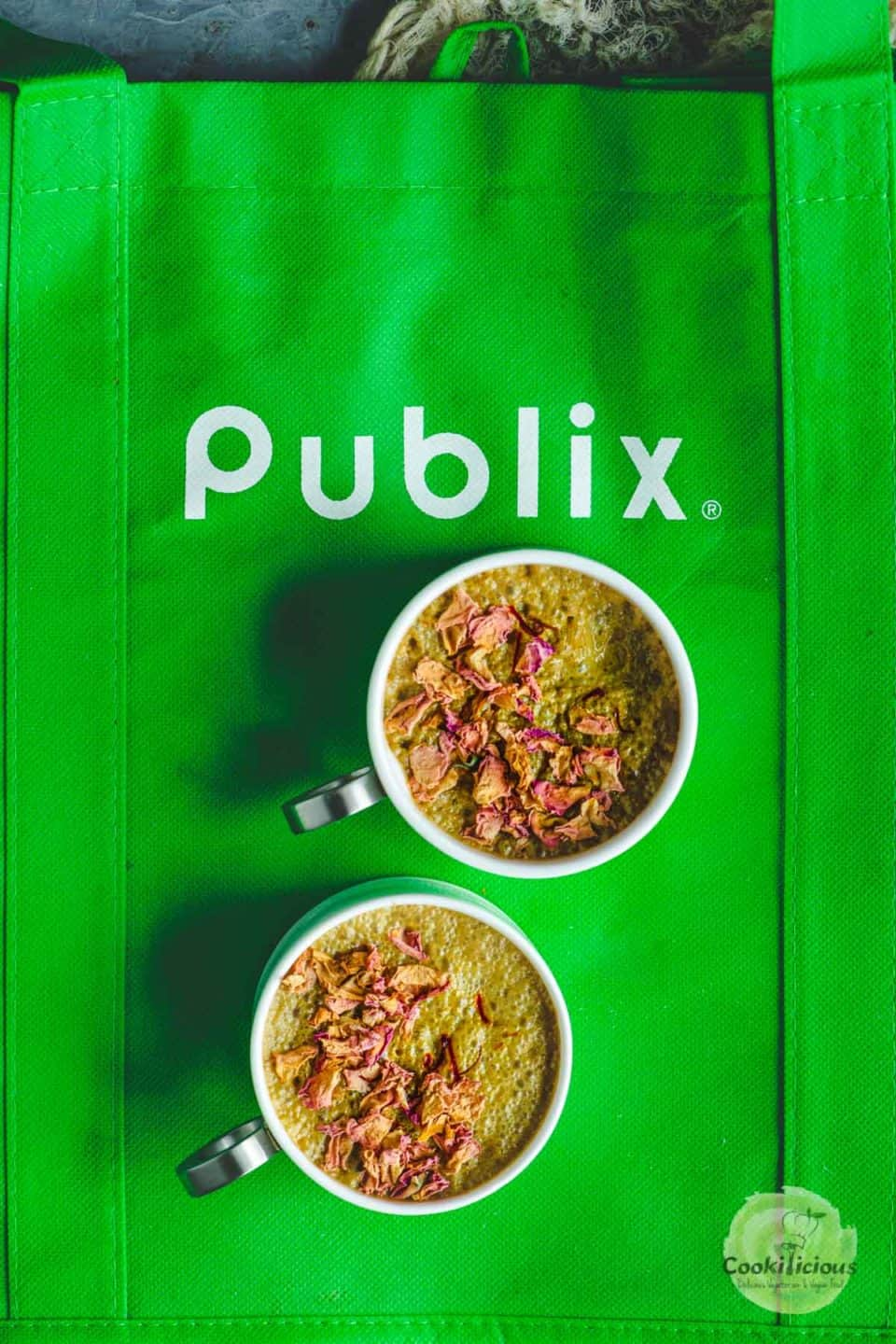 2 cups of Vegan Lavender Moon Milk placed over a Publix shopping bag