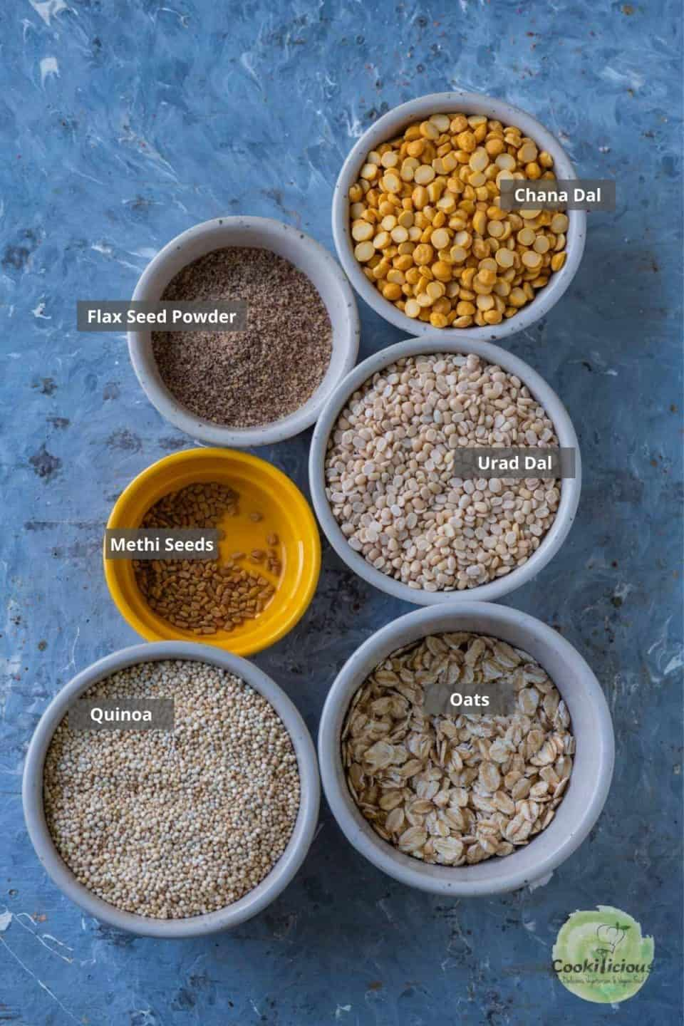 all the ingredients needed to make Quinoa Dosa placed on a table with labels on them