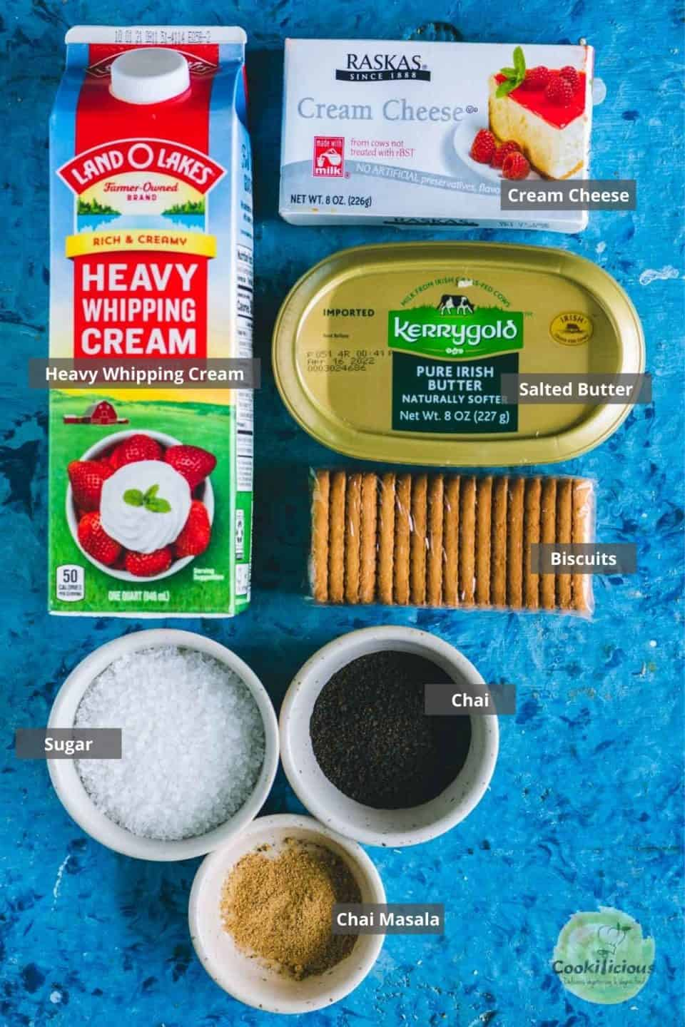 all the ingredients needed to make No-Bake Eggless Chai Cheesecake Jars placed on a table with labels on them