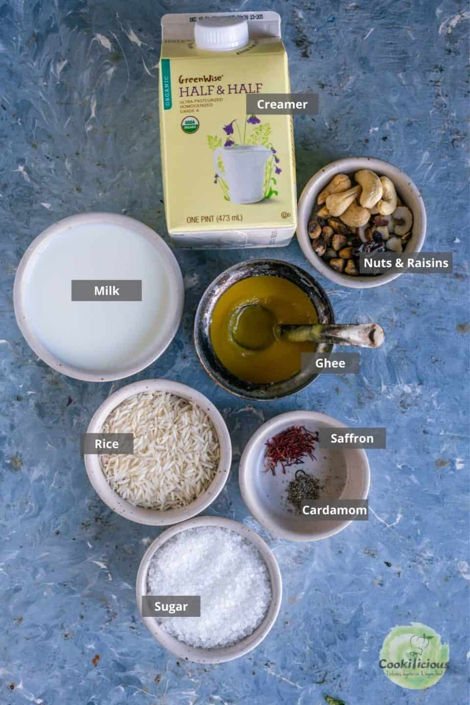 all ingredients needed to make paal payasam or kheer placed on a table with labels on them