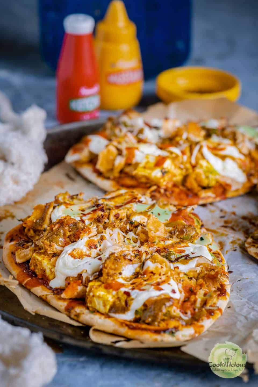 close up shot of Paneer Naan Pizza