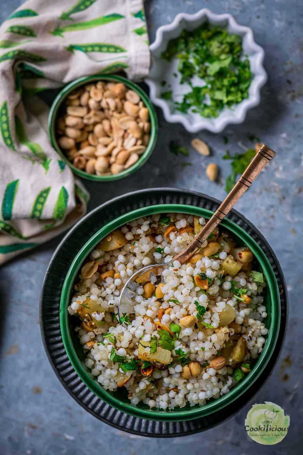 Sabudana Khichdi served next to a bowl of peanuts and cilantro