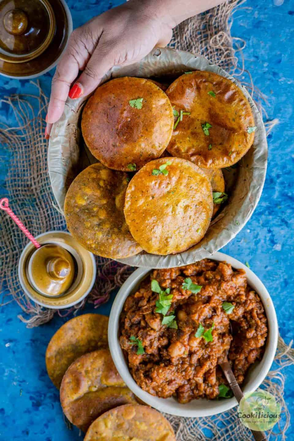 a couple of Sweet Potato Masala Puri placed next to a bowl of curry