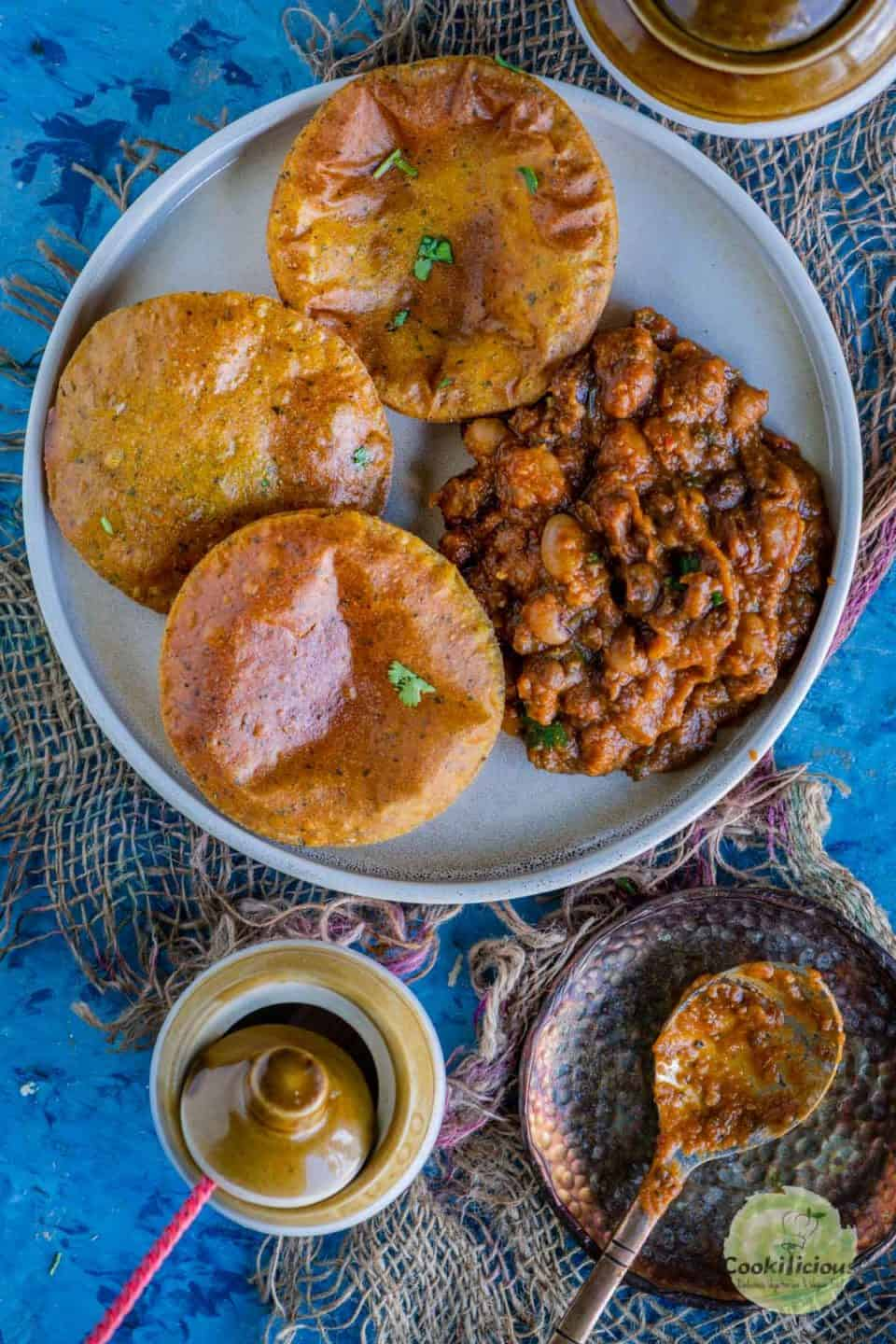 Sweet Potato Masala Puri served with curry on a plate