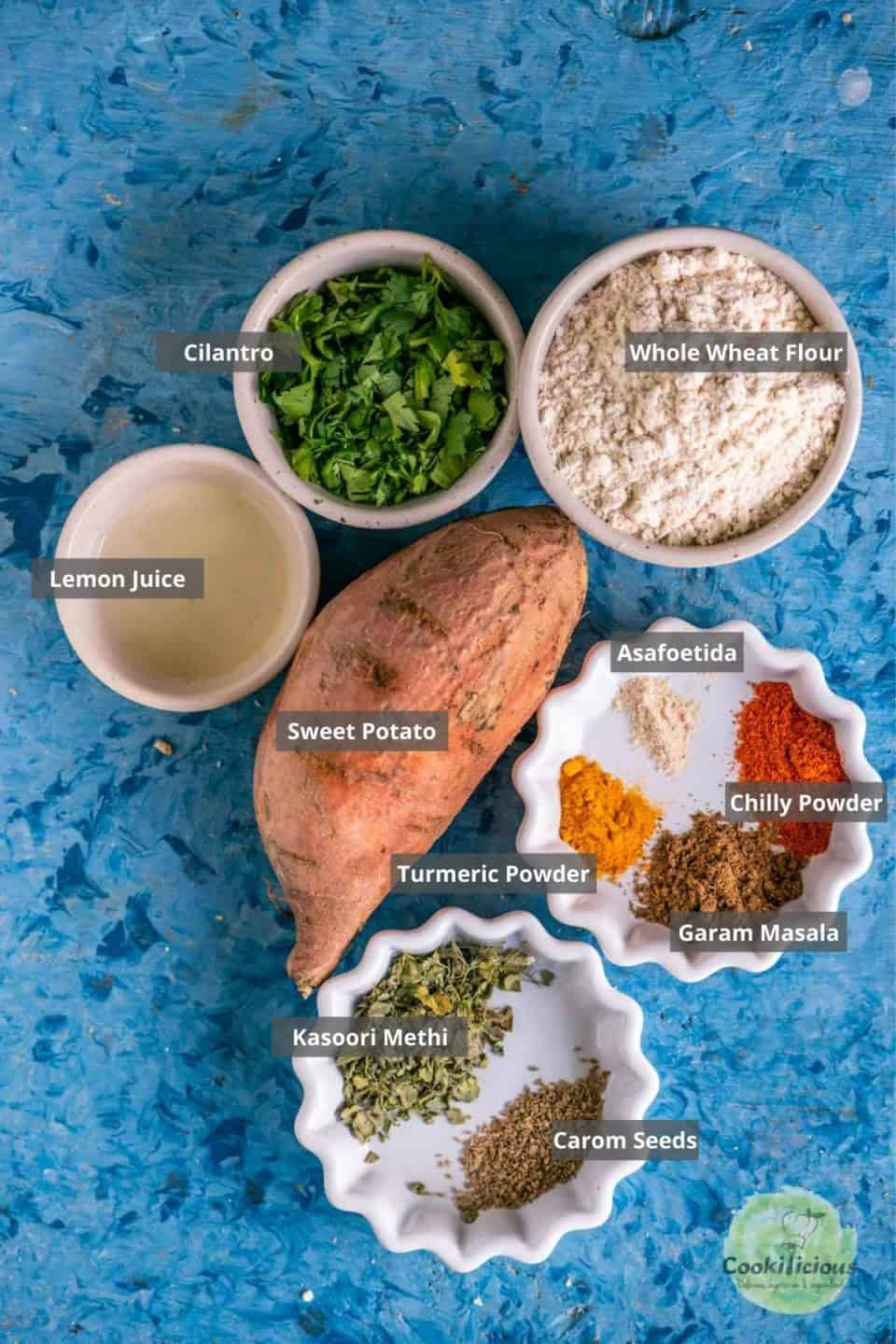 all the ingredients needed to make Sweet Potato Masala Puri on a table with labels on them